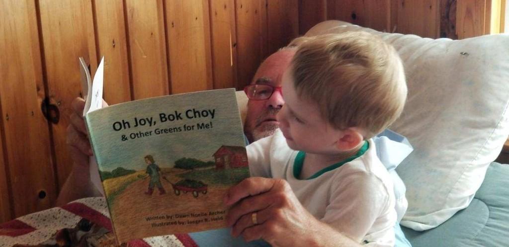 Little fan & Bapa reading together