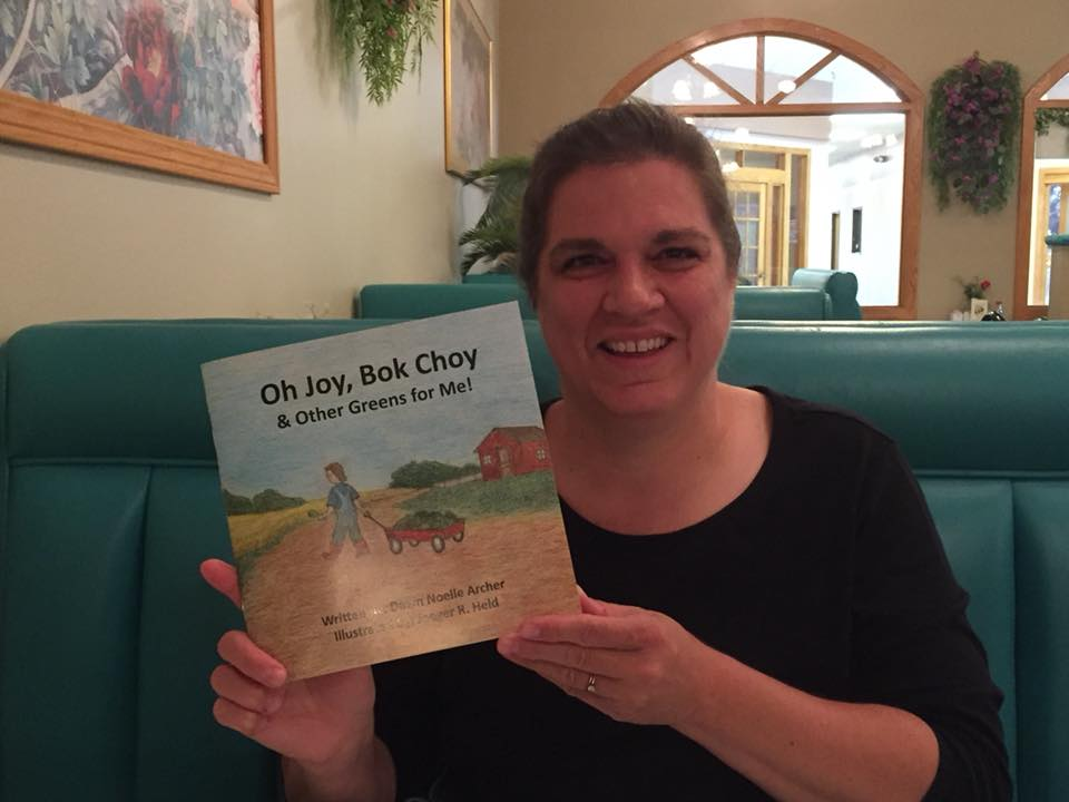 Holding the proof copy of my first children's book